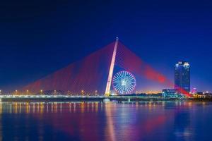 tran thi ly bridge and sun wheel in danang photo
