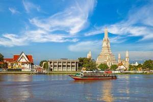 Wat Arun by Chao Phraya River in Bangkok, Thailand photo