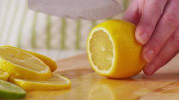 Slicing fresh lemons, closeup video
