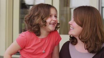 Portrait of mother and daughter video