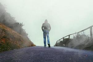 man trekking in the moutain in winter season photo