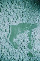 raindrops on the grey ground textured background photo