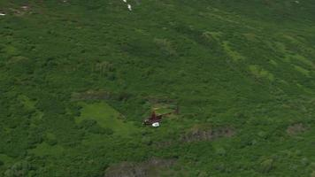 Aerial shot of helicopter over Alaska scenery video