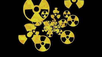 Yellow atomic nuclear radiation on a black background or a weapon of mass destruction concept video