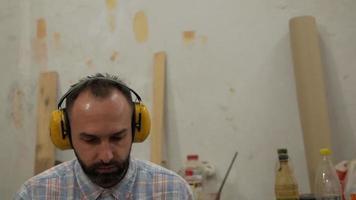 man listens to music on headphones video