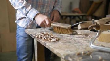 Aman cleans wooden chips with a brush video