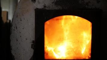 Fire is beautifully lit in a cast iron stove video