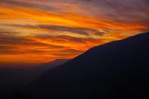 Orange sunset and mountains photo