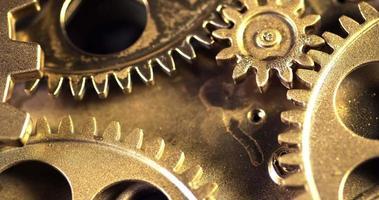 Close Up Golden Color Gears Mechanism Rotation video