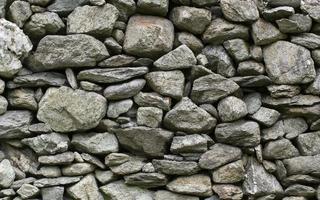 antiguo muro de piedra foto