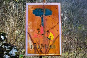 Old fire warning sign photo