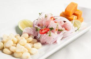 Ceviche Raw fish marinated on lime juice photo