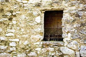 Old window with wire frame photo
