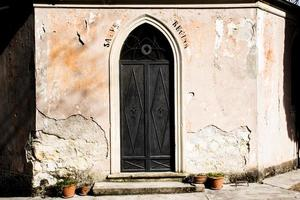 Black metal door with engraved heart and religious writing photo