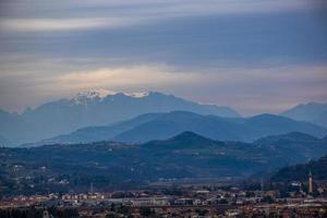 City and snow covered mountains photo