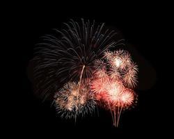 Explosión de fuegos artificiales coloridos festivos abstractos sobre fondo negro foto