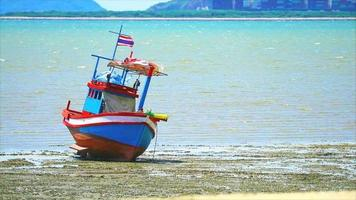 Focus to fishing boats on the sandy bottom of the sea video