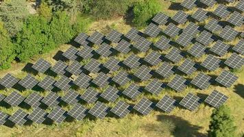Aerial shot of solar panels on hillside video
