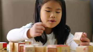 Young Asian girl stacking blocks video