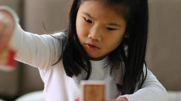 Young girl stacking blocks video