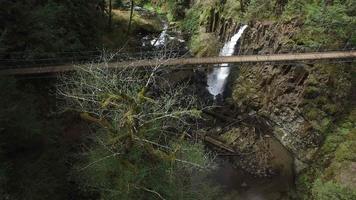 Aerial shot of suspension bridge and waterfall video