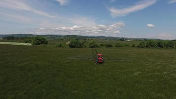 Aerial shot of tractor spraying grass seed farm video