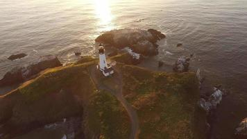 Aerial view of Yaquina Bay Lighthouse at sunset, Newport, Oregon video