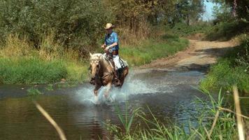 Woman riding horse through creek in super slow motion, shot on the Phantom Flex 4K at 1000fps video