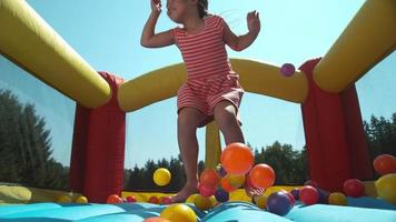 Girl bouncing in inflatable play house, super slow motion video