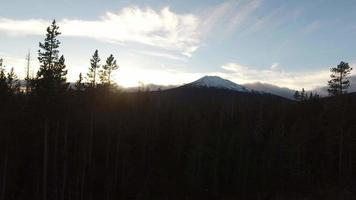 Aerial view of Oregon forest and Mt. Bachelor at sunset video