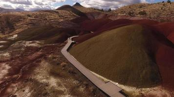 Aerial view of man walking on pathway at the Painted Hills, Oregon video