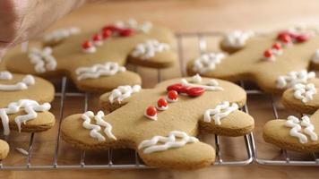Frosting gingerbread cookies, closeup video