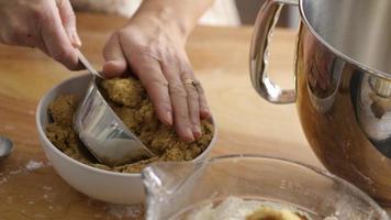Measuring brown sugar for baking video