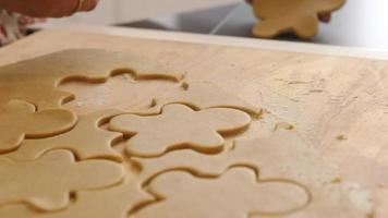 Cutting out gingerbread men cookies video