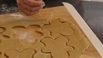 Placing gingerbread cookies on cookie sheet video
