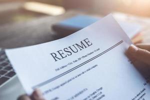 New graduate student holding resume application photo