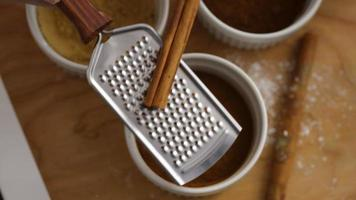 Grinding cinnamon stick in kitchen video