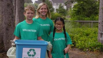 Portrait of volunteers at park cleanup video