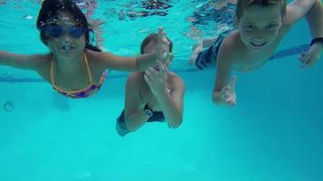 Underwater shot of kids in pool video