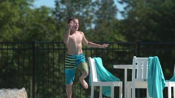 Jumping into pool in super slow motion video