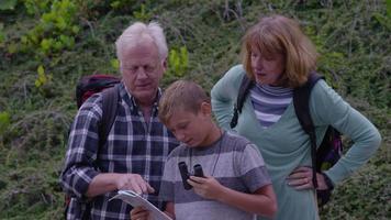 Senior couple with grandson looking through binoculars video