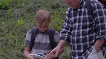 Senior man looking at map with grandson video