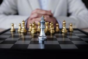 Business competition concept with table chess game photo