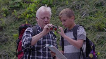 Senior man looking through binoculars with grandson video