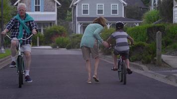 Grandparents riding bikes with grandson video