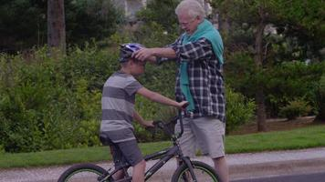 Senior man and grandson getting ready to ride bikes video