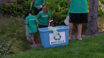 Group of volunteers cleaning up park video