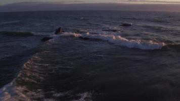 Aerial view of beach waves at sunset, Lincoln City, Oregon video