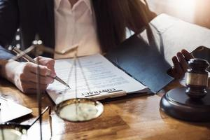 Law concept with lawyer holding pen with contract photo
