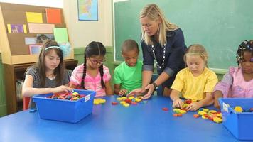 Students in school classroom experiment with shape blocks video